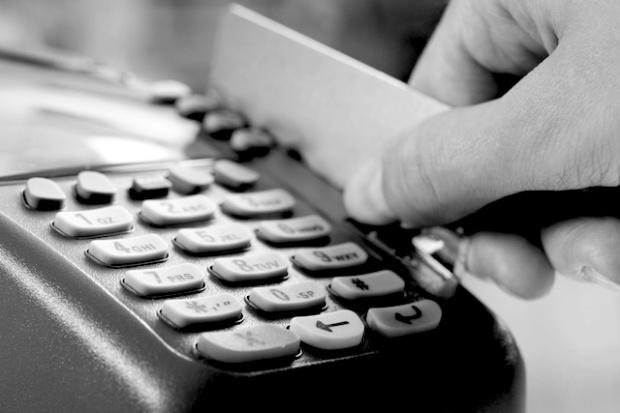 swiping-debit-card